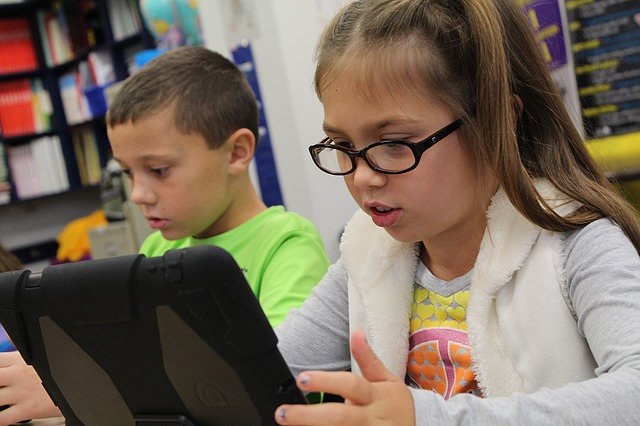 Students with technology in a classroom