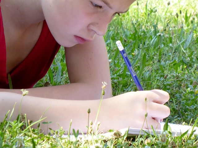 Teen writing a letter